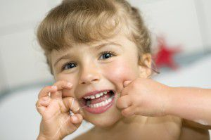 bigstock-Cute-girl-cleaning-teeth-by-fl-16359863